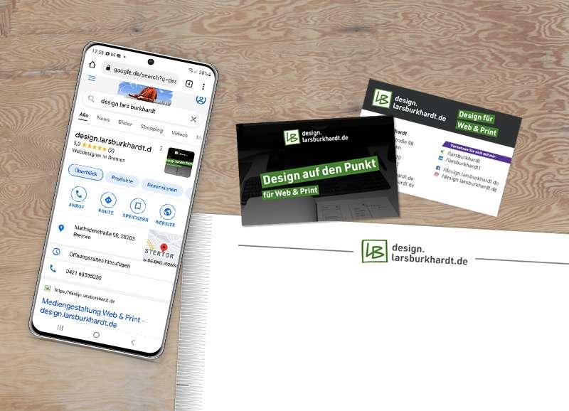 Bild mit Smartphone, Visitenkarten und Briefbogen